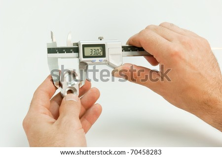 Handling of a caliper - stock photo