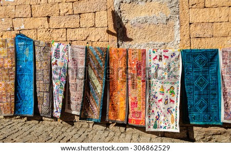 Handloom traditional and colorful clothes hanging Golden Fort of Jaisalmer, Rajasthan India with copy space - stock photo