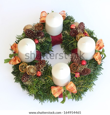 handmade advent wreath with white candles, cones, orange ribbons, isolated on white - stock photo