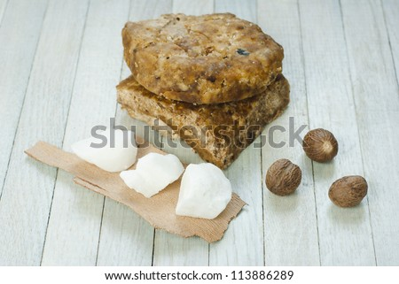 handmade african black soap and ingredients, shea butter nuts, and white shea butter - stock photo
