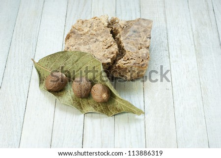 handmade african black soap and ingredients, shea butter nuts, leaf - stock photo