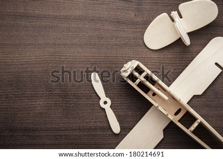 handmade airplane on the brown wooden table - stock photo