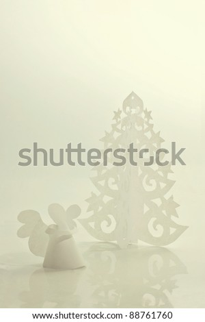 Handmade angel and Christmas tree cut out from office paper - stock photo