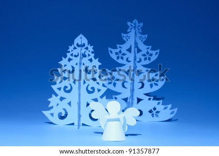 Handmade angel and Christmas tree cut out from  paper - stock photo