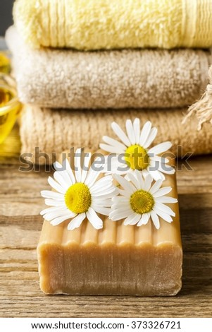 Handmade bars of soap and chamomile flowers