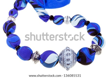 handmade blue silk and metal ball beads isolated on white background - stock photo