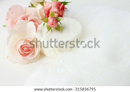 Handmade botanical soap fresh rose flowers soft natural foam healthy skin cleansing soft delicate focus - stock photo