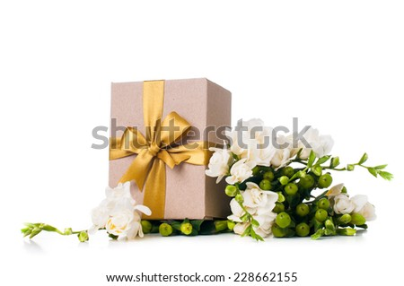 Handmade box with gift and freesia flowers on white background isolated - stock photo