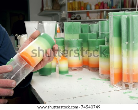 Handmade candles series,  remove the candle from the form - stock photo