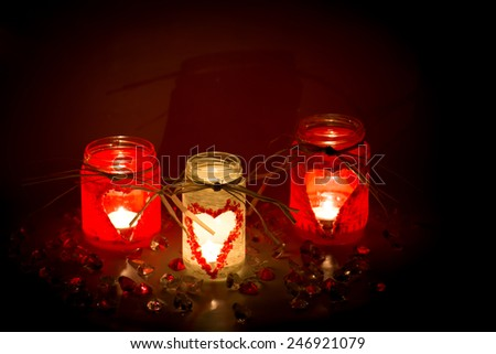 handmade candlesticks with heart theme - stock photo