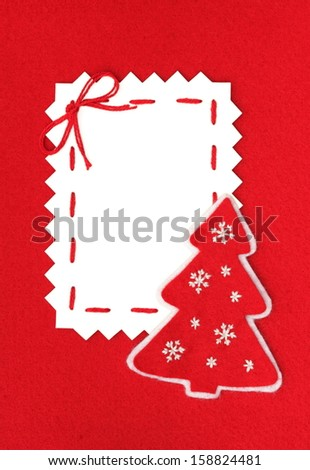 handmade card: Paper Sheet and Christmas tree on red  - stock photo
