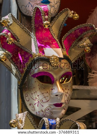 Handmade Carnival Venetian Mask in Gold and Pink - stock photo
