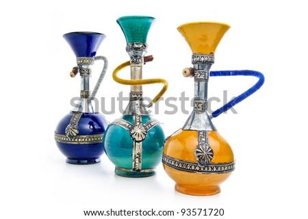 Handmade ceramic shishas on a white background - stock photo