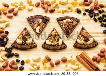 Handmade chocolate pizza with raisins and nuts - stock photo