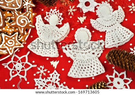 Handmade Christmas Crochet Angels and Snowflakes - stock photo