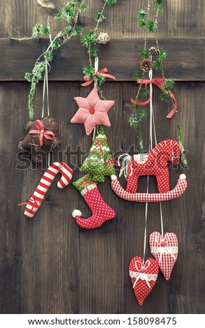 handmade christmas decoration hanging over rustic wooden background. vintage style picture - stock photo