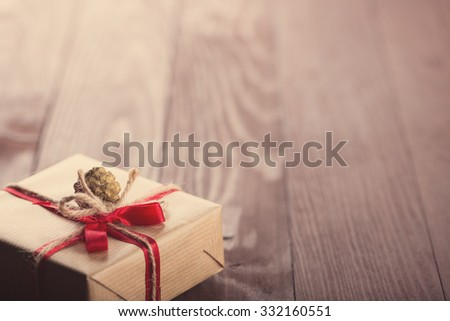 Handmade christmas gift box on wooden table