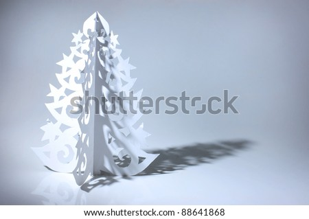 Handmade Christmas tree cut out from office paper - stock photo