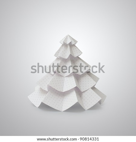Handmade Christmas tree cut out from office paper with small dots (file with clipping paths) - stock photo