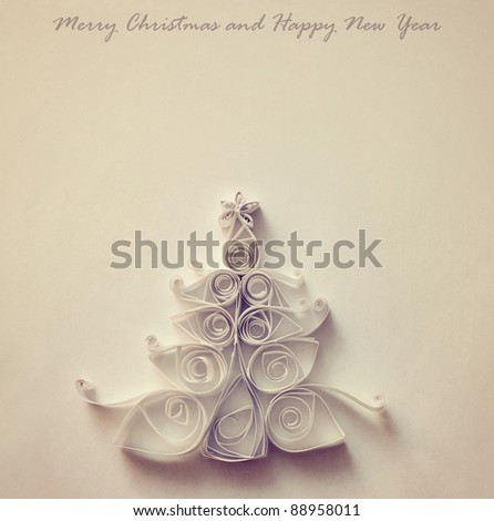 Handmade Christmas tree cut out from paper. Retro stylized. - stock photo