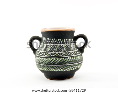 handmade clay pot decorated with traditional ornament - stock photo