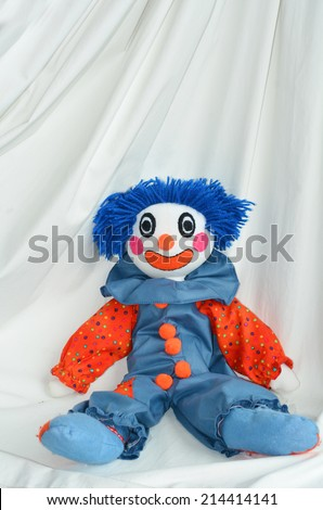 Handmade clown doll sit on white background. Concept photo of happy,happiness, sadness, sad, child, childhood, toy. copyspace - stock photo
