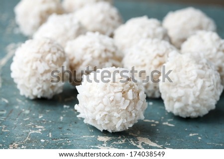 handmade coconut candies on vintage wood  - stock photo