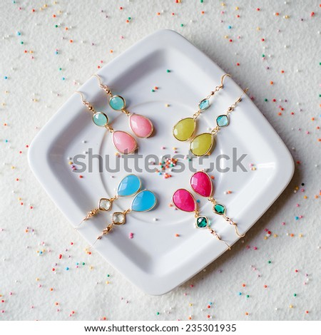 handmade colorful earrings with natural stones - stock photo