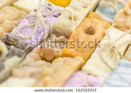 Handmade colorful natural soap background - stock photo