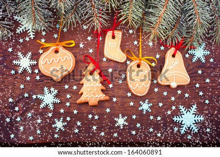 Handmade cookies with Christmas toys on wooden table. Christmas card. Free space for your text.  Christmas card - stock photo