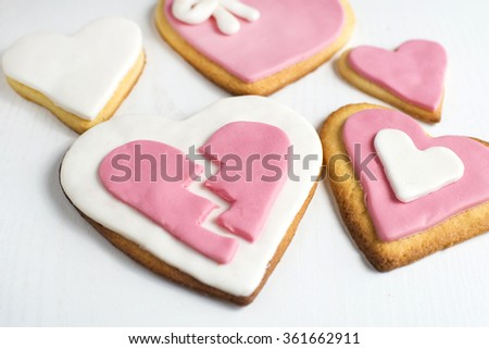 Handmade cookies with heart shape on white wood. - stock photo