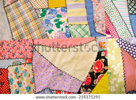 handmade crazy quilt with embroidered stitching - stock photo