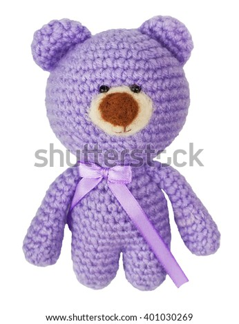 handmade crochet cute lilac bear doll isolated on white background.Crochet toy - stock photo