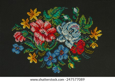 "Handmade cross-stitch ""Beautiful bouquet of roses, cornflowers, poppies on a black background "" is my own work - stock photo"