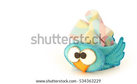 Handmade cup with foamy blue bird shape with candy inside for use as a souvenir at children's parties