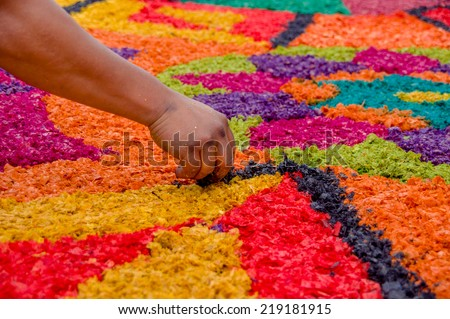 handmade easter carpets made from colored sawdust fruits and flowers in antigua guatemala - stock photo