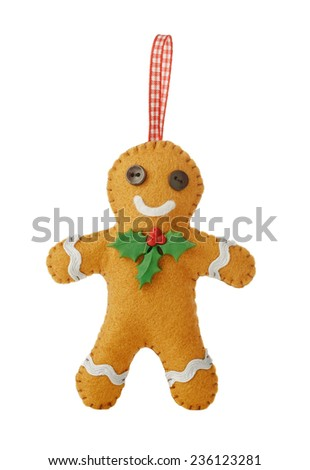Handmade felt gingerbread man with red ribbon for Christmas - stock photo