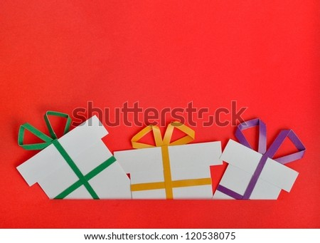 handmade gift on red background - stock photo