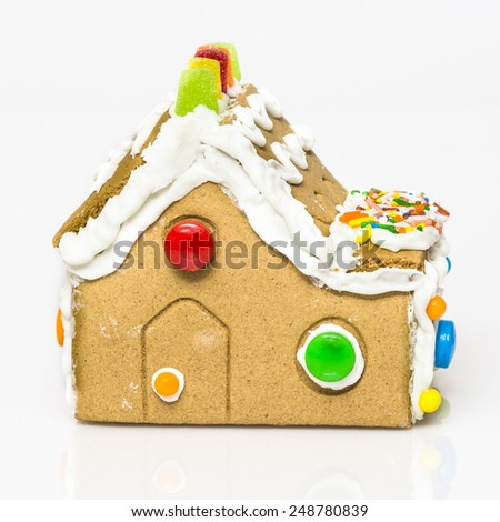handmade gingerbread house on white background - stock photo