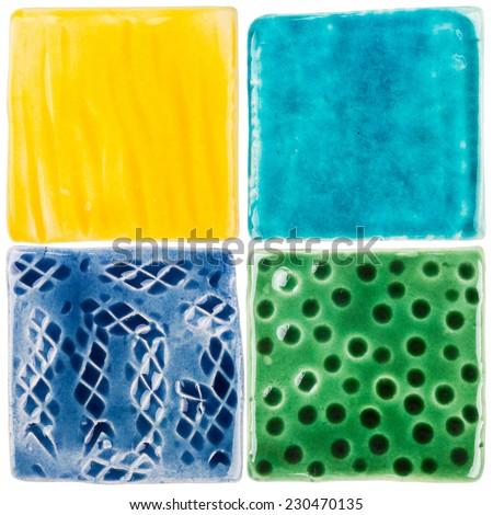 Handmade glazed ceramic tiles isolated on white - stock photo
