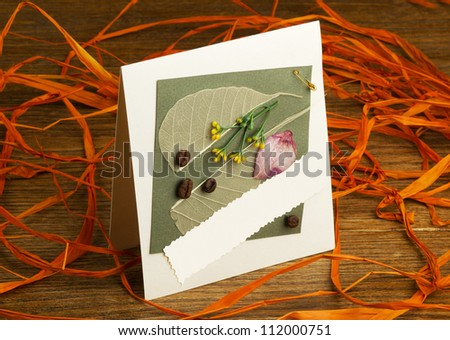handmade greeting card on a wooden table - stock photo