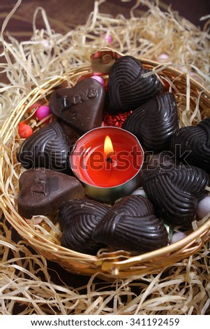 handmade heart shape chocolates with  red candle - stock photo