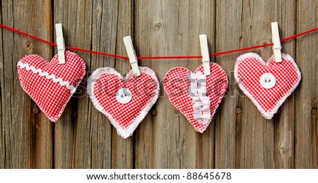 handmade hearts hanging on line - stock photo