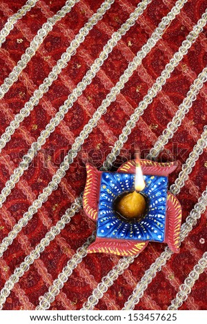 Handmade Indian Diwali Diya in Swastik Shape - stock photo