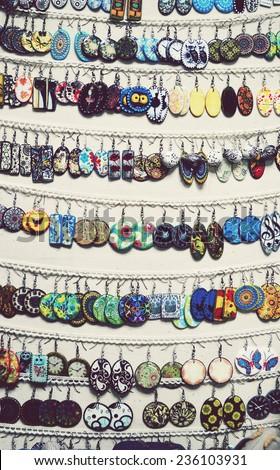 handmade jewelry, earrings, bracelets, pendants, epoxy resin - stock photo