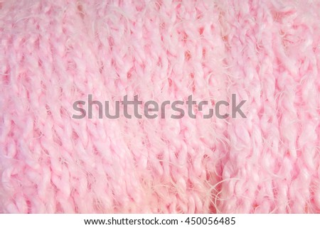 Handmade knitted pink scarf pattern, closed up texture.