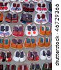 Handmade Laotian Baby Shoes sold at the Night Market in Luang Prabang - stock photo