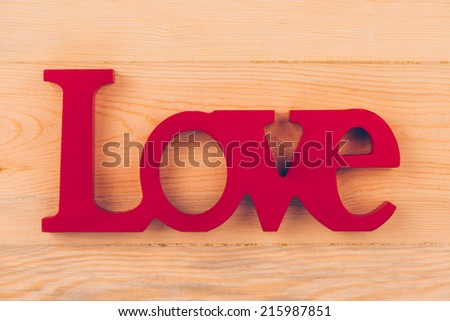 Handmade letters L O V E on wood. Valentine`s day concept  - stock photo