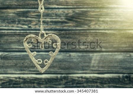Handmade love figurine on wooden background