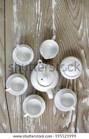 handmade mini tea set on wooden background - stock photo